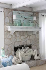 chalk painted 1970 s stone fireplace