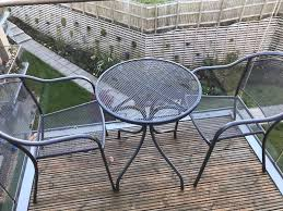 patio table and two chairs in
