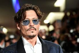 Johnny Depp covers the iconic Bob Dylan song and pays tribute to