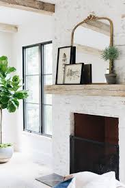 painted white brick fireplace with gold