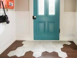 a tile rug within a hardwood floor