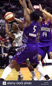 SPORTS San Antonio's Vickie Johnson gets a shot off against the ...