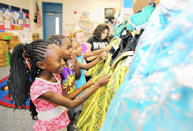 Disney donates thousands of Frozen costumes to local students ...