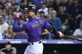 Former Rockies OF Carlos González, Mariners agree to minor league ...
