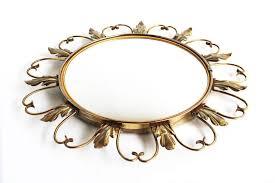vintage patinated metal sunburst mirror