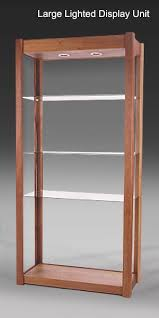 solid wood and glass shelving units