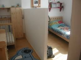 Splitting A Room In 2 With A Half Height Partition Wall Room Divider Ideas Bedroom Kids Shared Bedroom Kids Room Divider