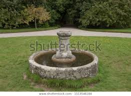 old stone water trough bird bath stock