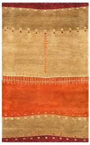 wool area rug in red tan orange beige