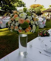 flower centerpiece in tall glass vases