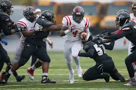 Coatesville running back Aaron Young, once committed to Michigan ...