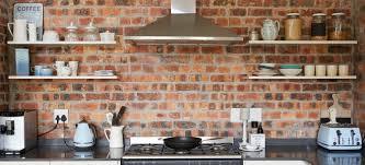 shelf brackets into a brick wall