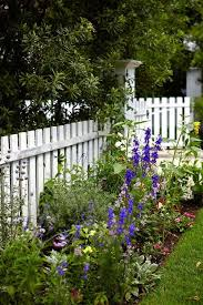 12 Charming Picket Fence Ideas Town Country Living Farmhouse Landscaping Farmhouse Garden Beautiful Gardens