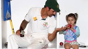 Mitchell Johnson with his daughter - ABC News (Australian Broadcasting  Corporation)