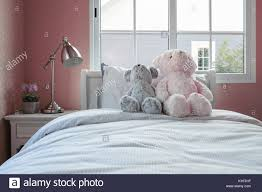 Kids Room With Dolls And Pillows On Bed And Bedside Table Lamp Stock Photo Alamy
