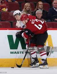Aaron Ness of the Arizona Coyotes checks Oliver Bjorkstrand of the... News  Photo - Getty Images