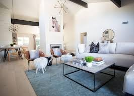 a blue area rug adds a pop of color to