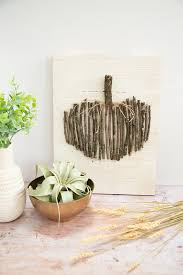 loisdiy wood branch pumpkin wall art