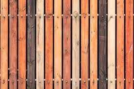Premium Photo Rustic Wooden Fence Made From Treated Differently Colored Boards Vertical Background Wall Made Of Vintage Pine Wood In Vintage Style