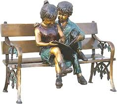 kids life size boy and girl sitting