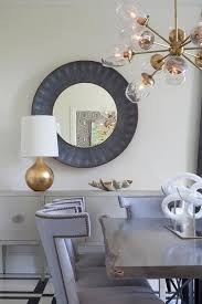 round gray faux reen mirror with