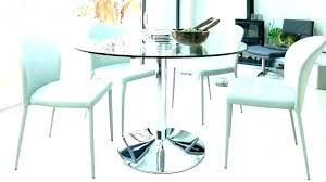glamorous round glass dining table set