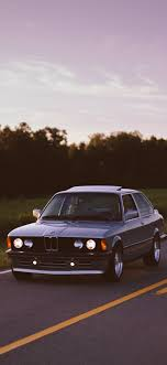 1125x2436 bmw old cars trees