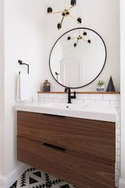 vanity bathroom with round mirror