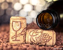 bottle of wine and drawn cork stoppers