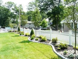 Front Yard Inspiration Tree And Shrub Plantings With Cobblestone Border Vinyl Fence Landscaping Fence Landscaping Front House Landscaping