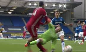 Van Dijk injured by Pickford in ...