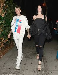 Aaron Carter holds hands with Porcelain Black
