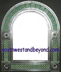 arched tin framed hand hammered mirror