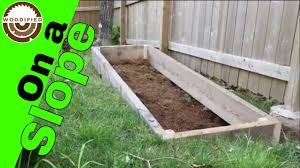 How To Build A Raised Garden Bed On A Slope Youtube