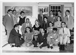 Aaron Copland poses with a group of Latin American students at the home of  former U.S. Ambassador Adolf Berle and his wife in Great Barrington, MA. -  Images - BSO Archives