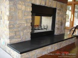 fireplace with stone veneer and black