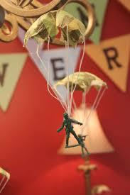 Army Men Parachuting Put Invitation Information On The Parachute