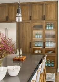 brown wood kitchen cabinets with