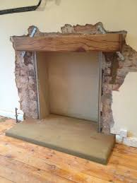 installing beam above a fireplace