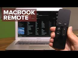 macbook with an apple tv remote