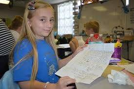 Braden River Elementary students connect with pen pals in China - Abby Burns  with her letter, with the picture her pen pal drew her.   Your Observer