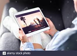 Streaming movie with VOD service. Woman watching online tv series stream.  Video on demand app in tablet screen. Television program or film Stock  Photo - Alamy
