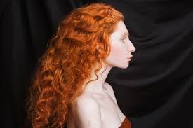 woman with long curly red flowing hair
