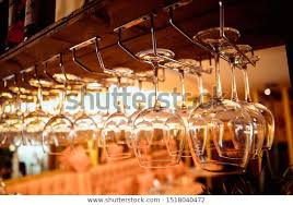 glasses wine glasses hanging above bar