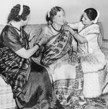 Dr. Helen Keller (center) is assisted by her companion, Polly ...