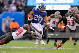Running back Saquon Barkley of the New York Giants carries the ball...    New york giants, New york giants football, New york football