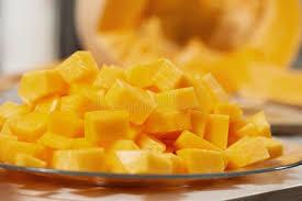 cut orange pieces stock photos