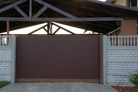 Brown Metal Gates And Gray Concrete Fence Stock Photo Download Image Now Istock