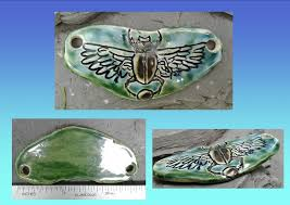 ceramic hieroglyph winged disc amulet