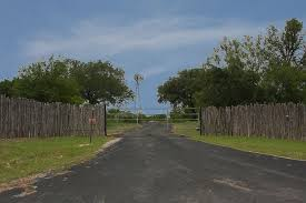 Texas Ranch Entrance Surrounded By Cedar Fence Entrance Gates Front Gates Fence Gate